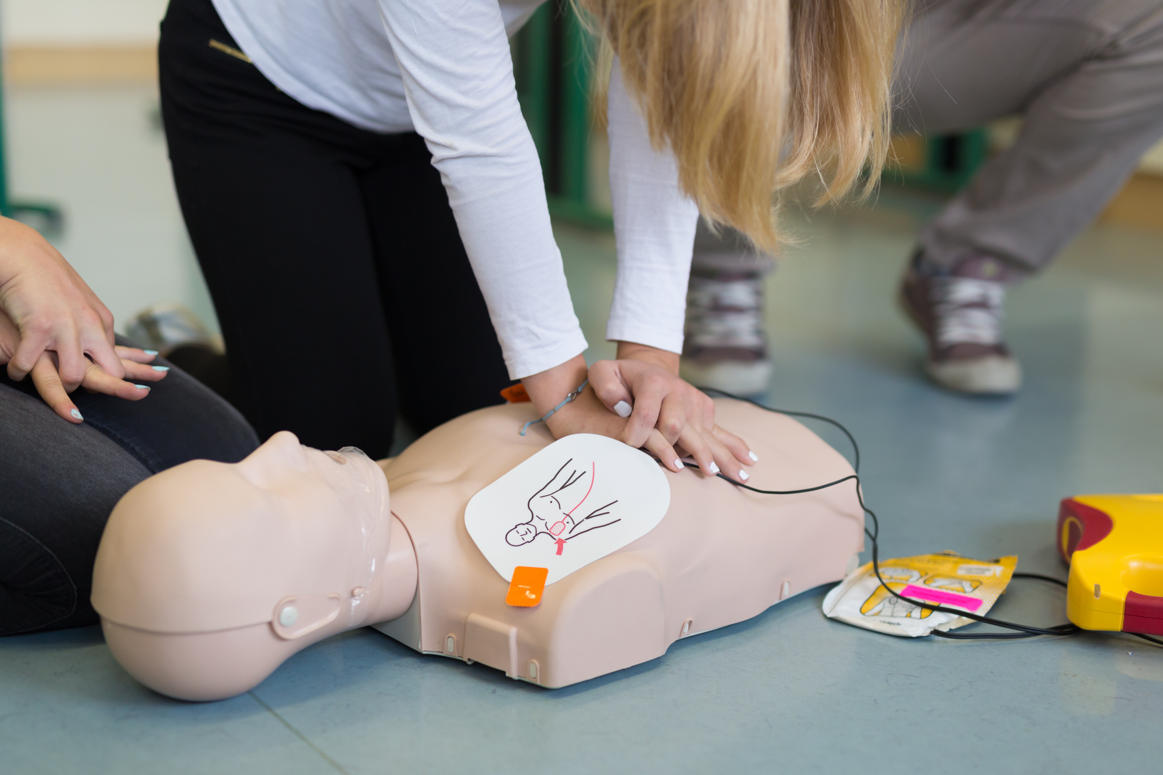 First aid cardiopulmonary resuscitation course using automated external defibrillator device, AED.