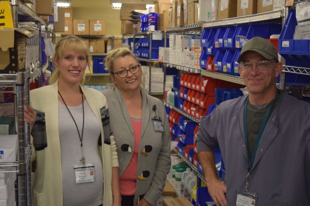 pharmacists smiling while posing for camera