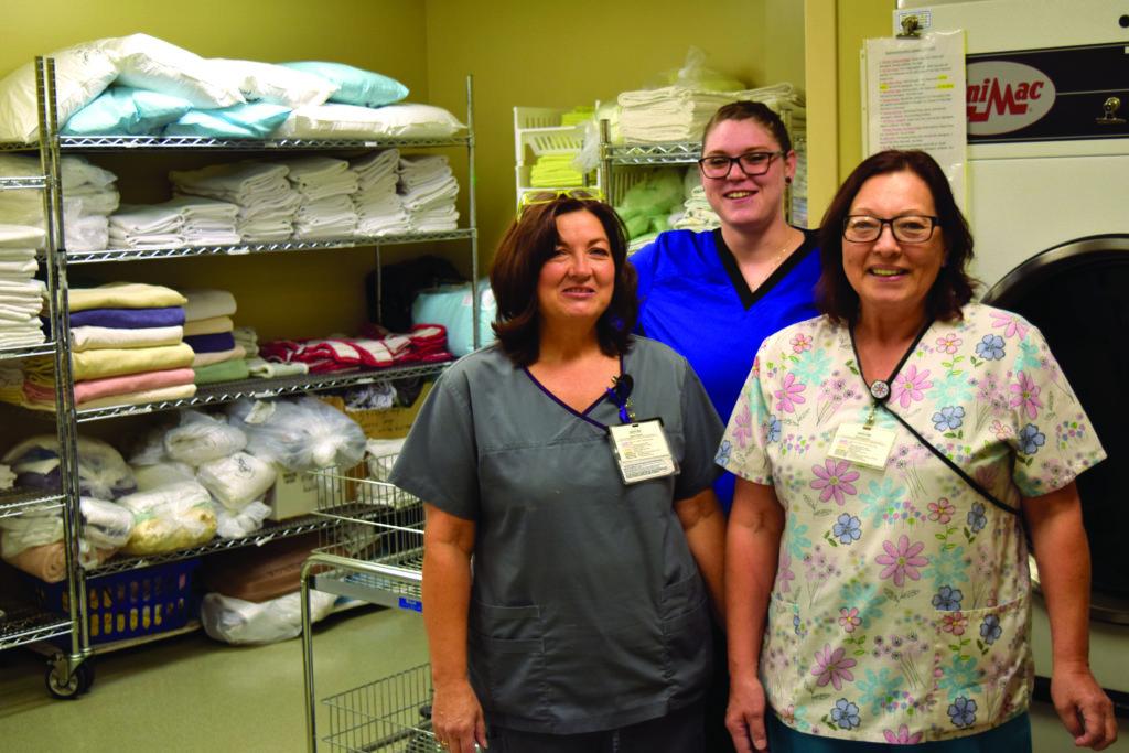 nurses standing in a hallway