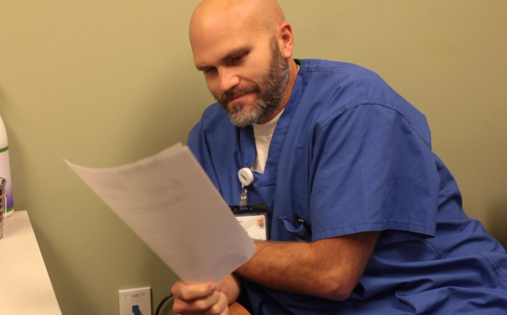 Luke Hemphill consults with pain clinic patient.